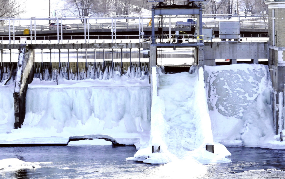 The Kennebec River at the dam below the Margaret Chase Smith bridge in Skowhegan is frozen. Officials are keeping an eye on ice conditions as spring progresses.