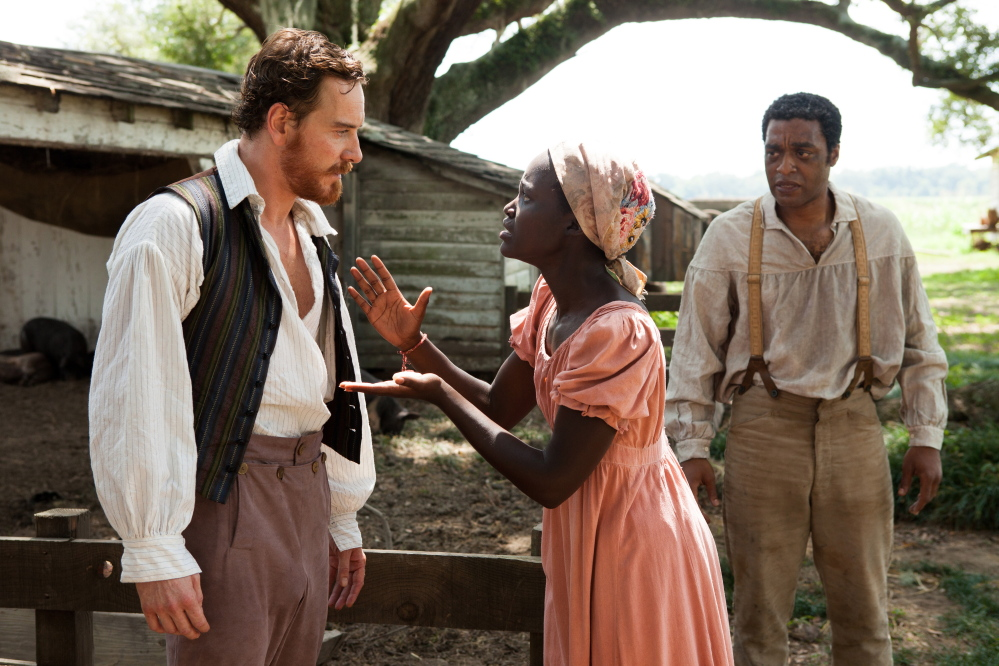 "Michael Fassbender, Lupita Nyong'o and Chiwetel Ejiofor, right, in ""12 Years a Slave."""