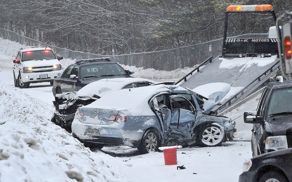 Two cars involved in a fatal crash on Chadbourne Road/Route 35 in Standish are readied for removal from the road. The 5 a.m. collision left a man dead and the surviving driver critically injured. Over the past 10 years, 184 crashes have occurred on this stretch of road.