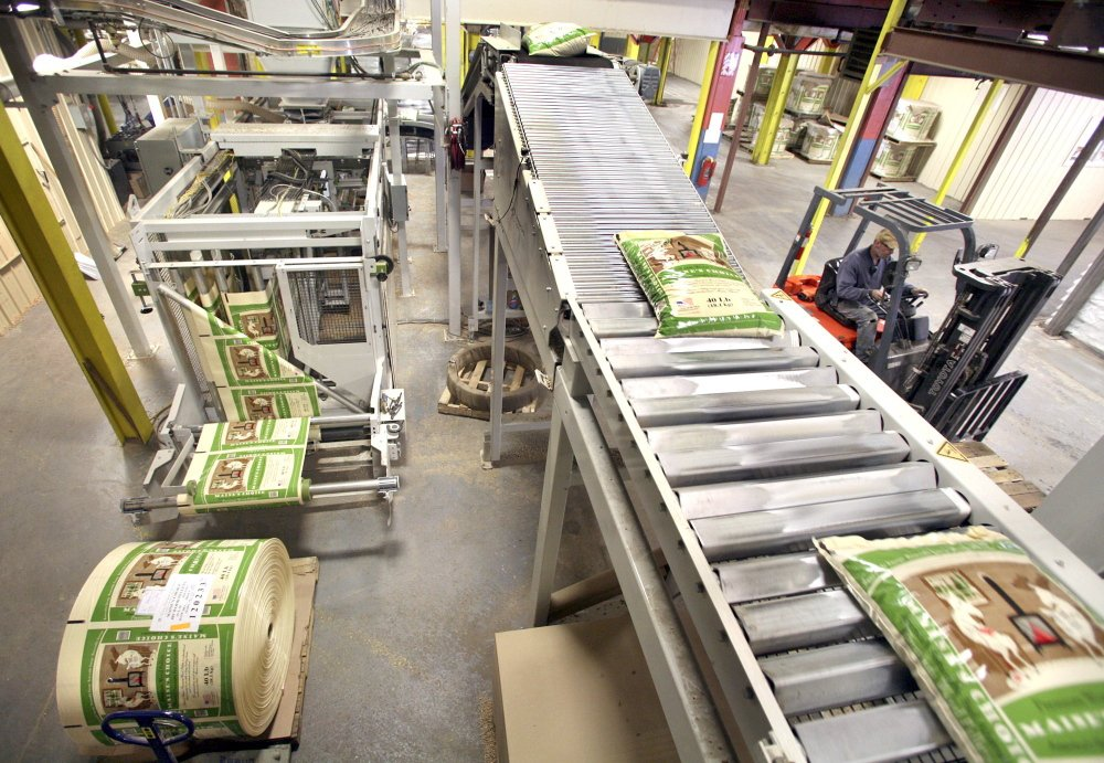 Forty-pound bags of Maine's Choice Premium Wood Pellets move along a conveyor belt at the operating plant of Geneva Wood Fuels in Strong. Demand for wood pellets this winter has been high.