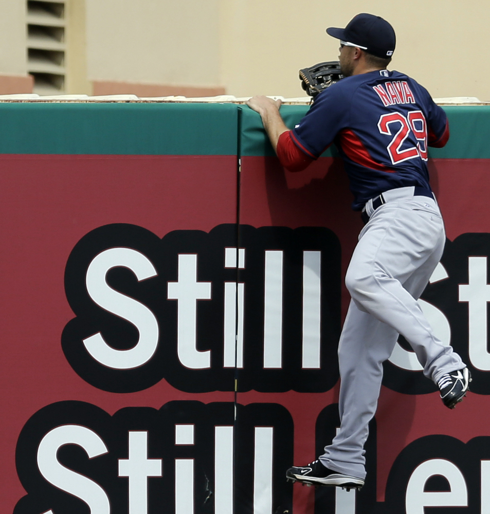 Boston left fielder Daniel Nava climbs the outfield wall in a vain attempt to snag Xavier Scruggs' two-run blast during Wednesday's exhibition loss to St. Louis.