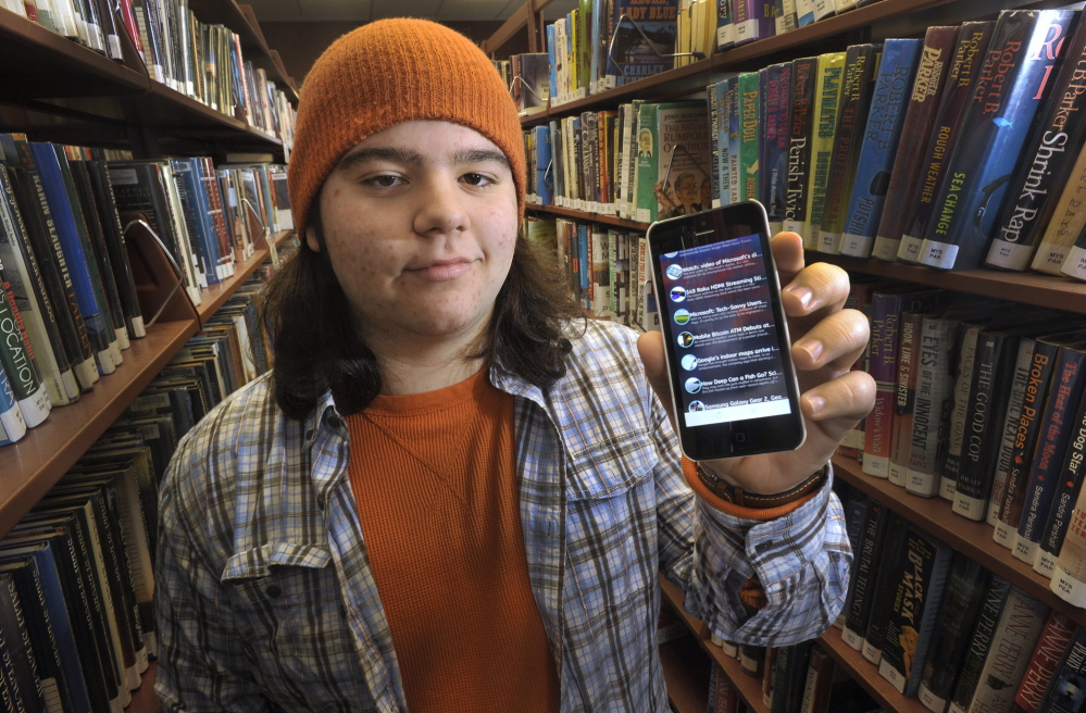Julian Wyzykowski of Cape Elizabeth displays W8, a free Apple app for iPhone and iPod Touch devices that serves as a single source for news articles in various topic categories.