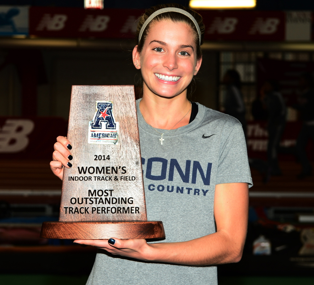 UConn's Emily Durgin proudly displays the award she won last weekend at the American Athletic Conference indoor track and field meet at New York.
