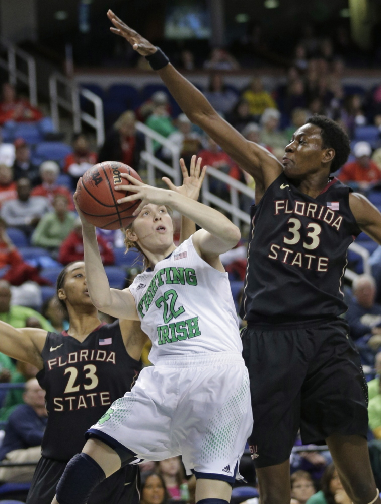 Notre Dame's Madison Cable is pressured by Florida State's Natasha Howard, 33, and Ivey Slaughter, 23, during Friday's ACC tourney game, won by the Irish.