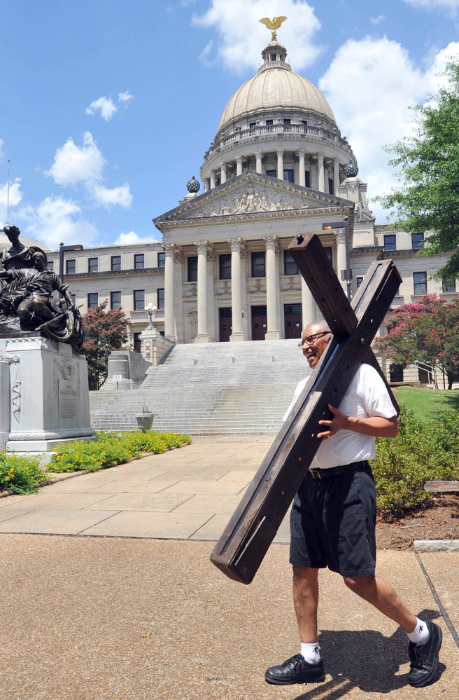 "A man heads for a religious gathering outside Mississippi's Capitol in 2013. A ""religious-freedom"" bill widely seen as a door to discrimination of gays is being debated in the state."