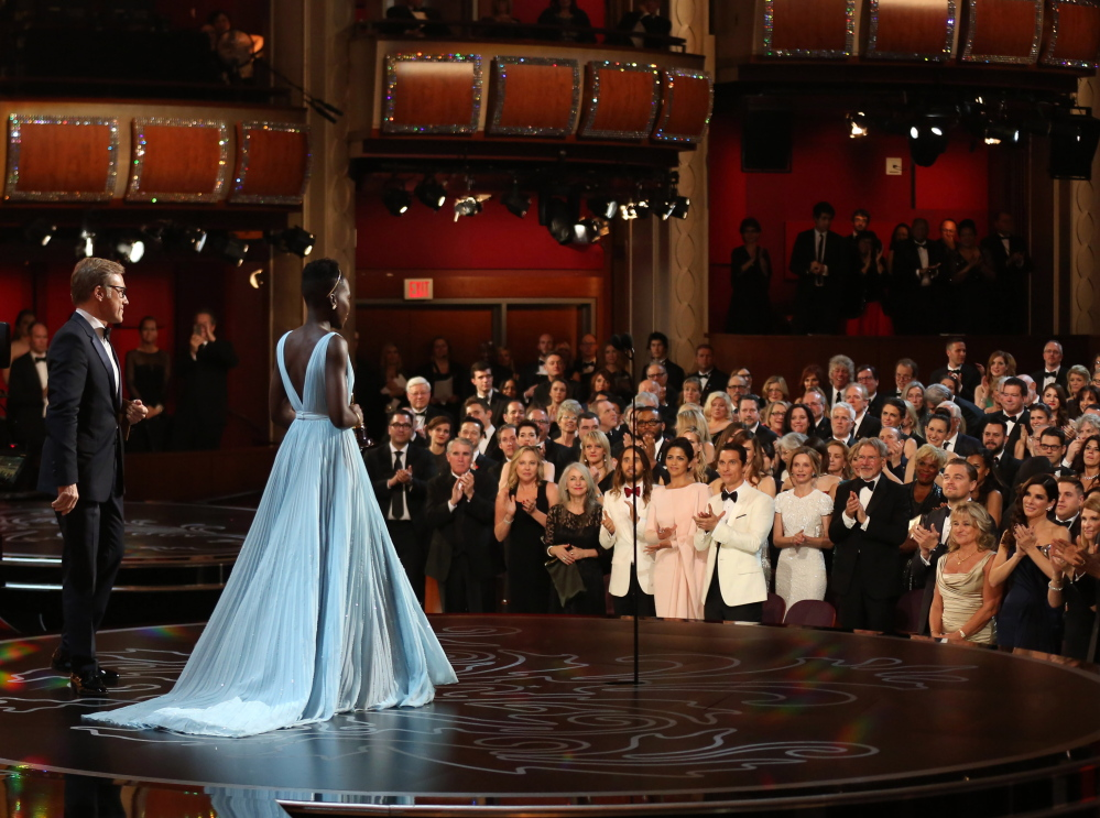 "Lupita Nyong'o received a standing ovation at the Academy Awards for her portrayal of a young slave in ""12 Years a Slave,"" and for winning the supporting actress Oscar."