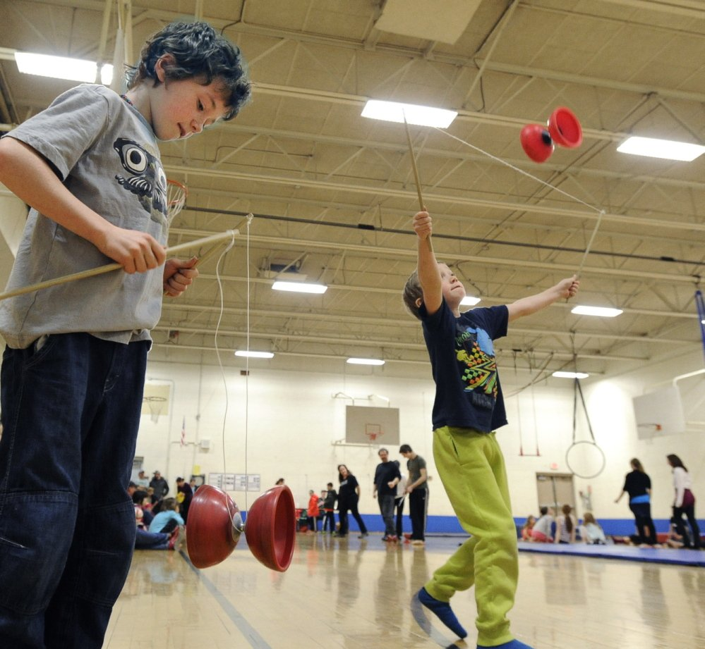 John Patriquin/Staff Photographer Brothers Jules Fertig, 8, and Rendle Fertig, 5, practice diabolo during Circus Atlantic's open house at Reiche Community School in Portland on Saturday.