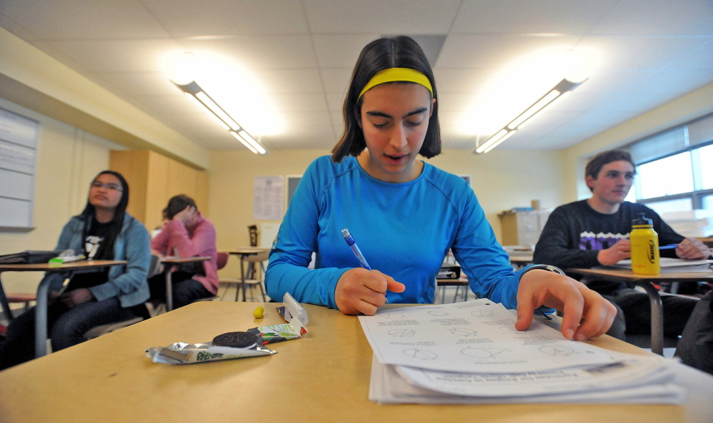 Ursula Hebert-Johnson, 17, a senior at Waterville Senior High School, works on a math equation Wednesday, March 5, 2014 during math team practice.