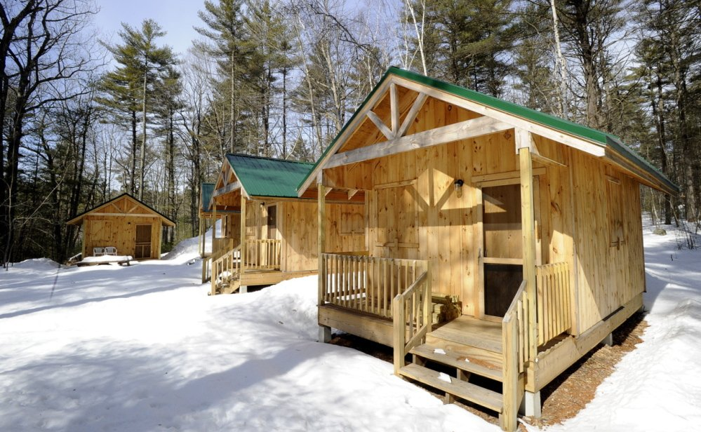 National Guard units from as far away as Portland, Ore., will begin upgrading facilities at Camp Hinds in Raymond next month, including building more cabins like these.