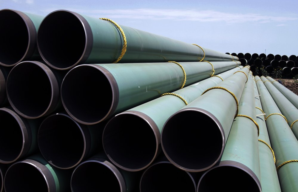 Hundreds of drilling pipes are stacked at a rail center in Gardendale, Texas, part of the expansion of America's natural gas industry.