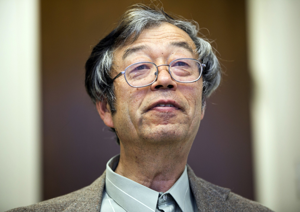 Dorian S. Nakamoto , the man identified by Newsweek as Bitcoin's founder, talks with reporters March 6. He claims he has nothing to do with Bitcoin.