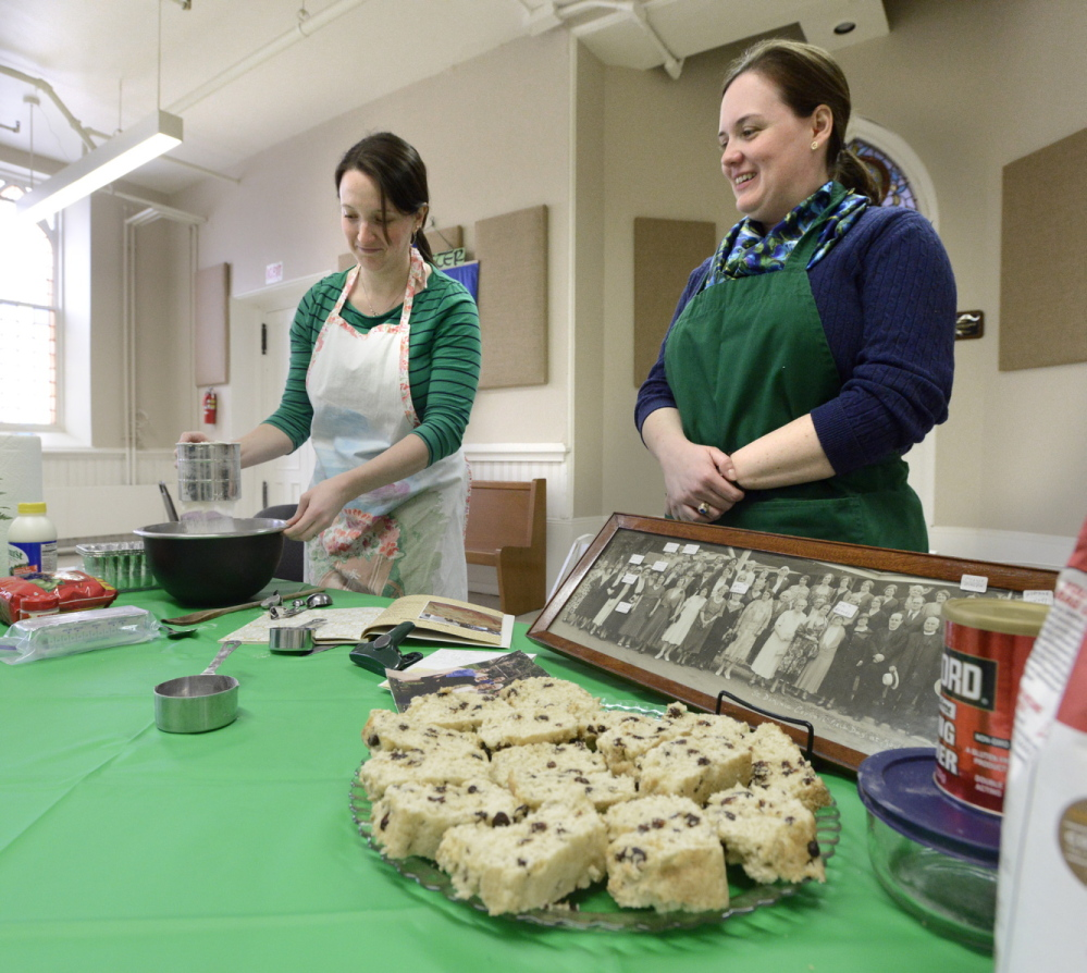 Sisters Kim Kelley Frost and Stephanie Kelley sift the flour for their version of Irish soda bread, which they eat every St. Patrick's Day in memory of their late grandmother, Helen Kelley.