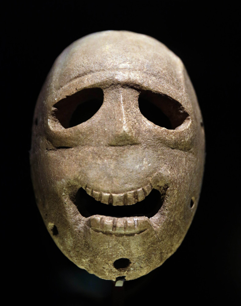 A 9,000-year-old mask is on display at the Israel Museum in Jerusalem.