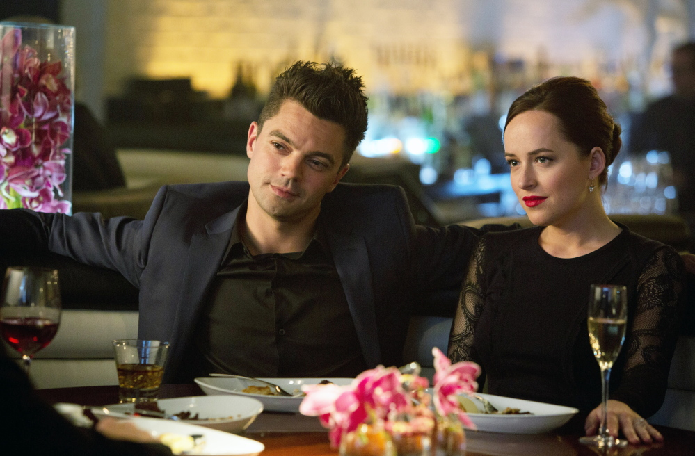 "Dominic Cooper, left, and Dakota Johnson in a slower-paced scene from ""Need for Speed."""