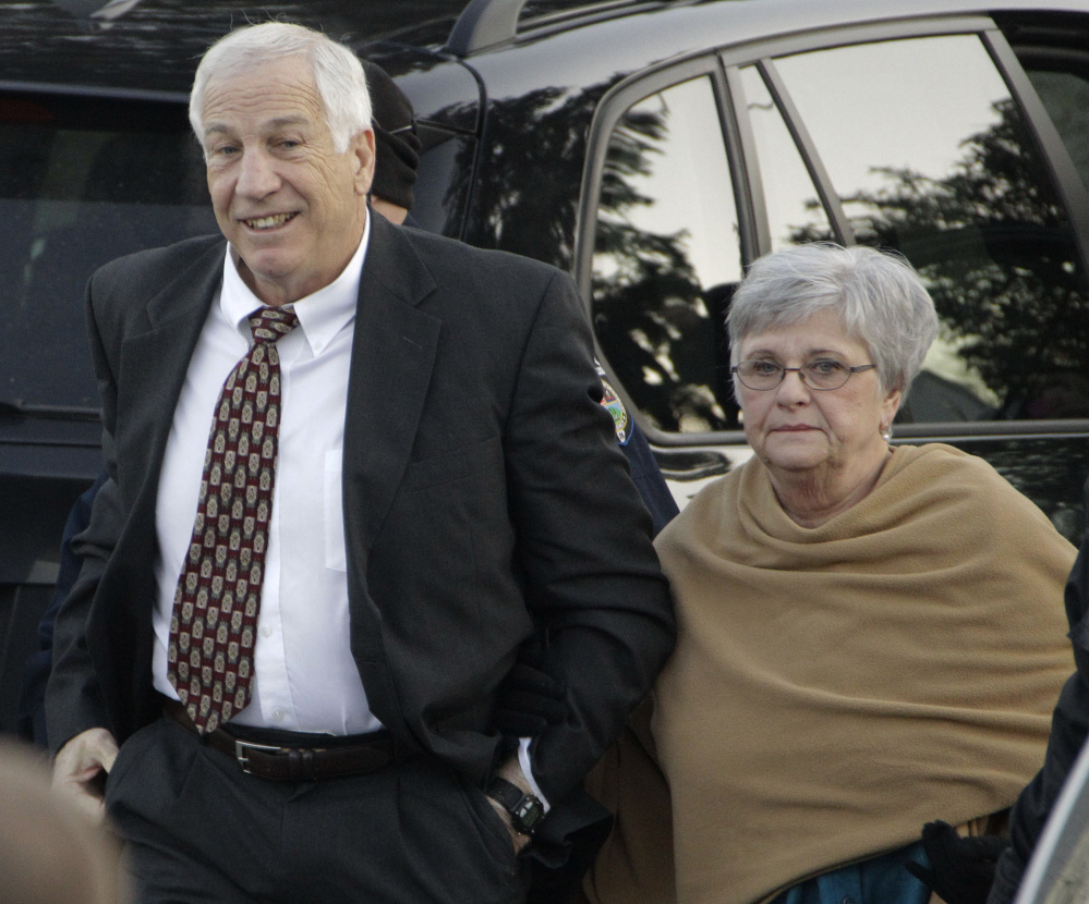 Dottie Sandusky says she 'definitely' believes her husband, former Penn State assistant football coach Jerry Sandusky, was wrongly convicted of sexually abusing boys.