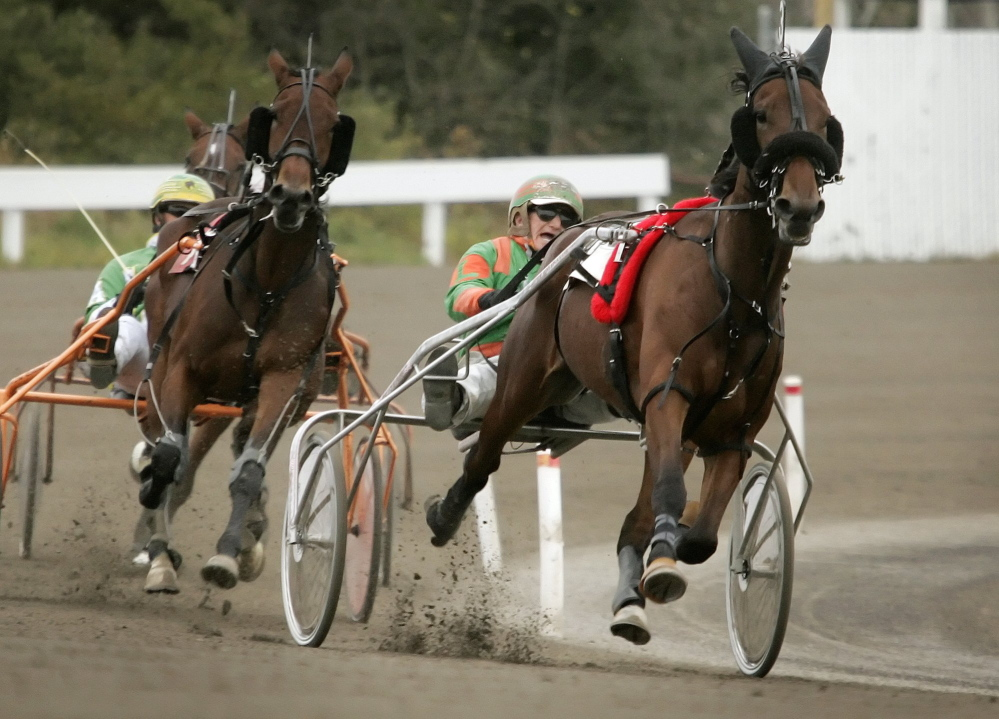 Competitors head down the final stretch during a race in October 2009 at Scarborough Downs. A track official says the two casinos in Maine make it impossible for the Downs to survive without slot machines.