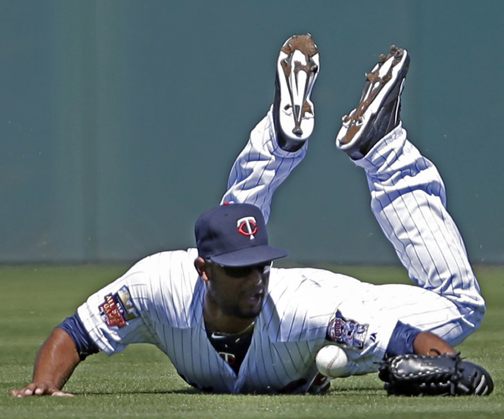 Aaron Hicks, playing center field for the Minnesota Twins, dives but can't handle a single by Boston's Mike Napoli in the second inning of a 4-3 exhibition win by the Red Sox at Fort Myers, Fla., on Thursday.