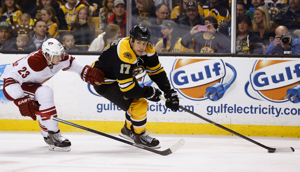 Boston Bruins' Milan Lucic looks for an opening around Phoenix Coyotes defenseman Oliver Ekman-Larsson in the second period Thursday.