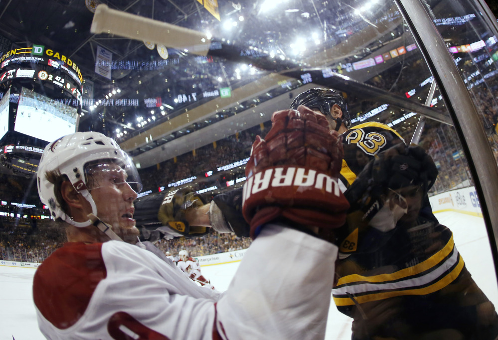 In this photo taken with a fish eye lens, Phoenix Coyotes' Shane Doan loses his stick after being hit by Boston Bruins defenseman Zdeno Chara in the second period Thursday.
