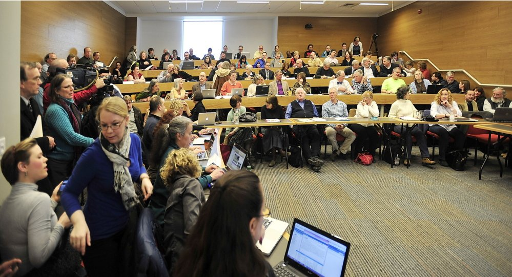 A crowd of professors and instructors gathers at a Faculty Senate meeting Friday to hear USM President Theodora Kalikow announce cuts to the school's budget which could result in as many as 50 faculty and staff layoffs.