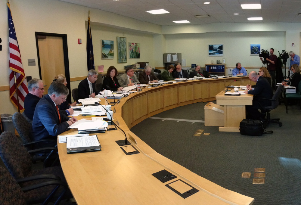 Members of the Legislature's Government Oversight Committee question five CDC officials at the State House on Friday.