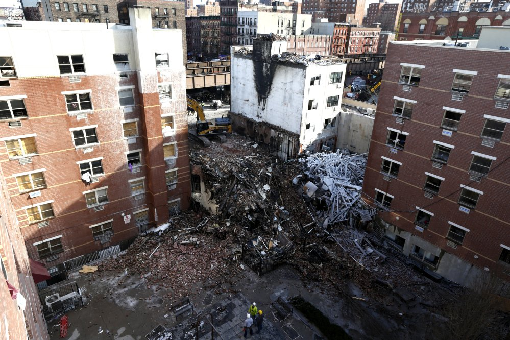 Rubble is seen Friday, two days after a natural gas explosion leveled two apartment buildings in New York. Workers searched the rubblie using sound devices to probe for voices and telescopic cameras to peer into small spaces, holding onto the possibility of finding survivors.