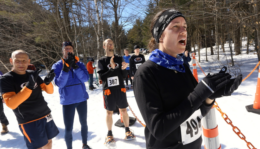 Saco's Rebecca Miller cheers on her fellow Trail Monsters at the finish line at Bradbury Mountain State Park, scene of snowshoe and trail running races – all of which require monstrous grit.
