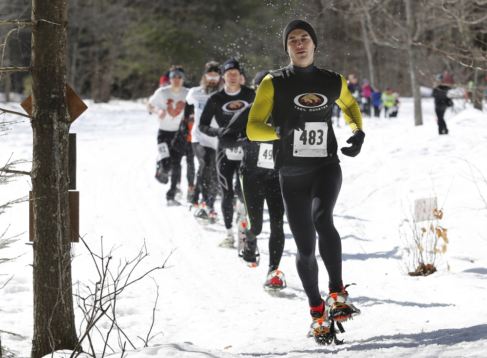 Cumberland's Andy Kiburis leads a pack of runners during last Sunday's Bradbury Blizzard snowshoe race, a rugged 5-mile trek at Pownal's Bradbury Mountain. Kiburis finished in 38 minutes, 27 seconds, tops among the 52 finishers.