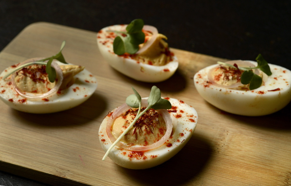 The list of appetizers at Gather includes deviled eggs with saffron and paprika.