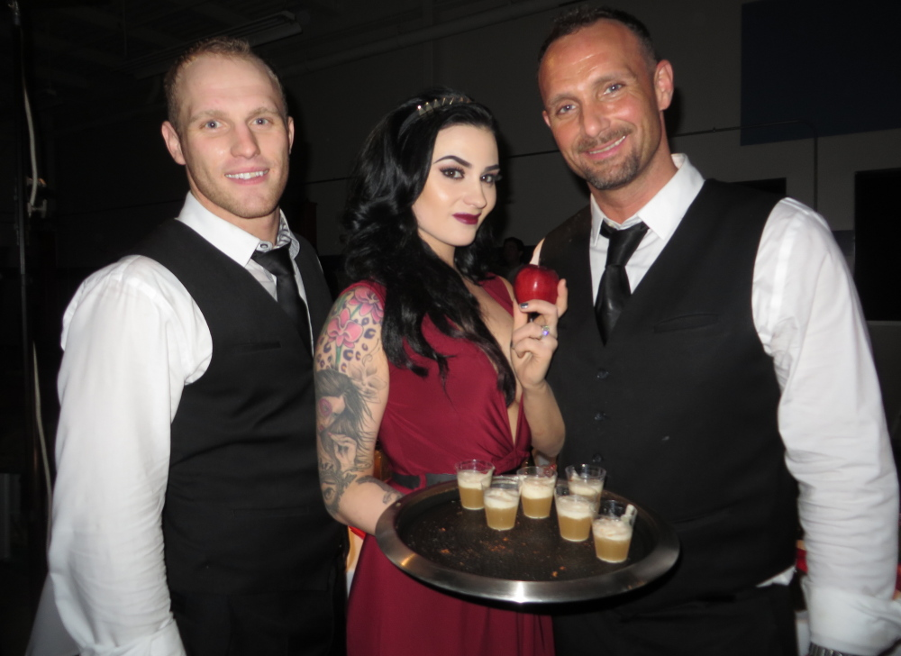 Steve Murray, Jessica Candage and Joshua Miranda, representing Top of the East, tempt guests with Snow White's Poison, the People's Choice award-winning cocktail at the Maine Restaurant Week Signature Event in Scarborough last Sunday night.