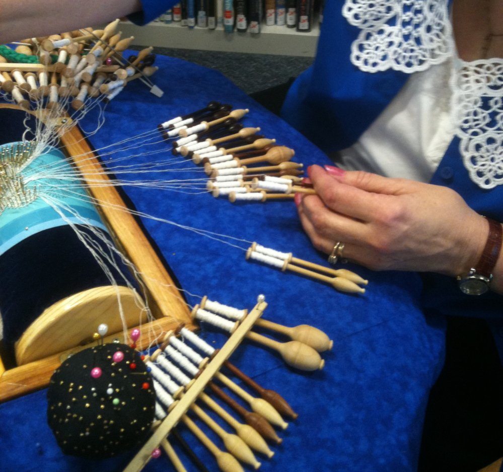 At the Scarborough Public Library's 2013 Textile Day, an artisan demonstrates how to create bobbin lace.
