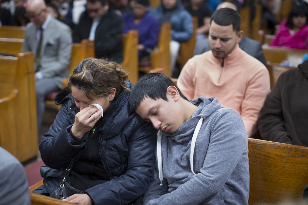 Parishioners mourn during Sunday services at the Church of God of Third Avenue as the congregation welcomed members of the Spanish Christian Church that was destroyed by Wednesday's explosion in New York City.