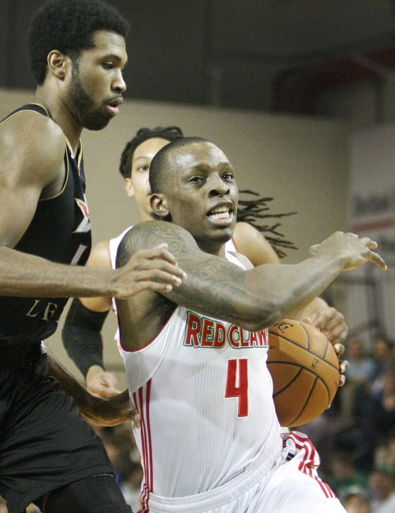 Guard Frank Gaines of the Maine Red Claws drives past the Erie BayHawks' Scott Suggs during first-half action of Sunday afternoon's game at The Expo.