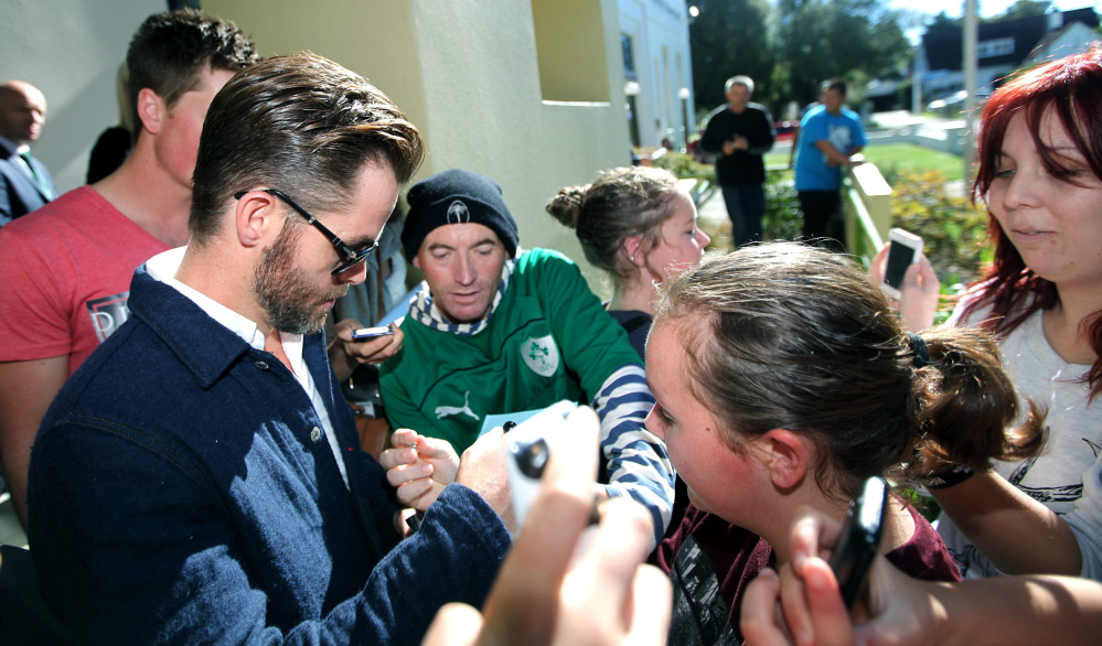 Actor Chris Pine signs an autograph outside the courthouse in Ashburton, New Zealand, on Monday after pleading guilty to a drunken driving charge.