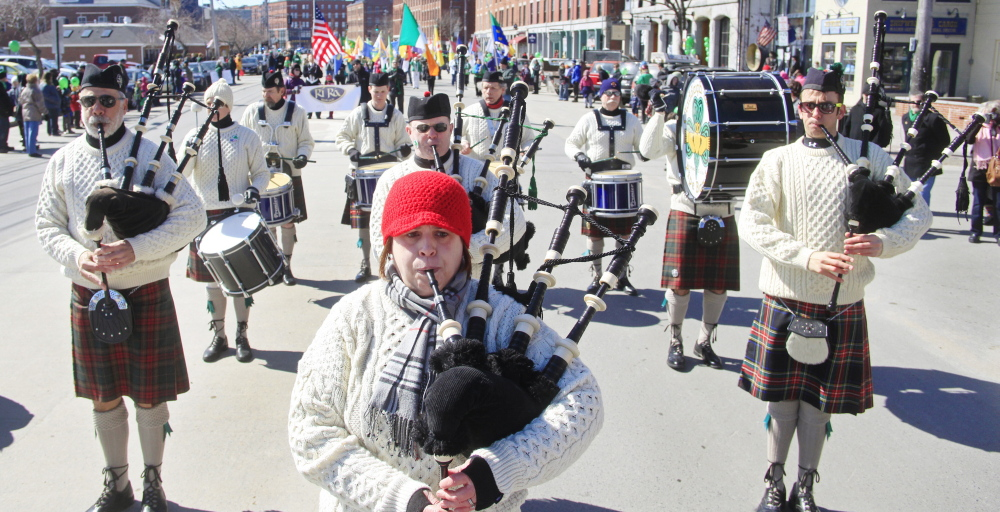 The Claddah Mohr Pipe Band fills Commercial Street with music during the St. Patrick's Day parade in Portland on Sunday.