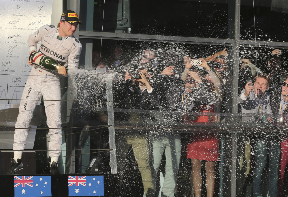 Mercedes driver Nico Rosberg of Germany sprays champagne in celebration after winning the Australian Formula One Grand Prix at Albert Park in Melbourne, Australia, on Sunday.