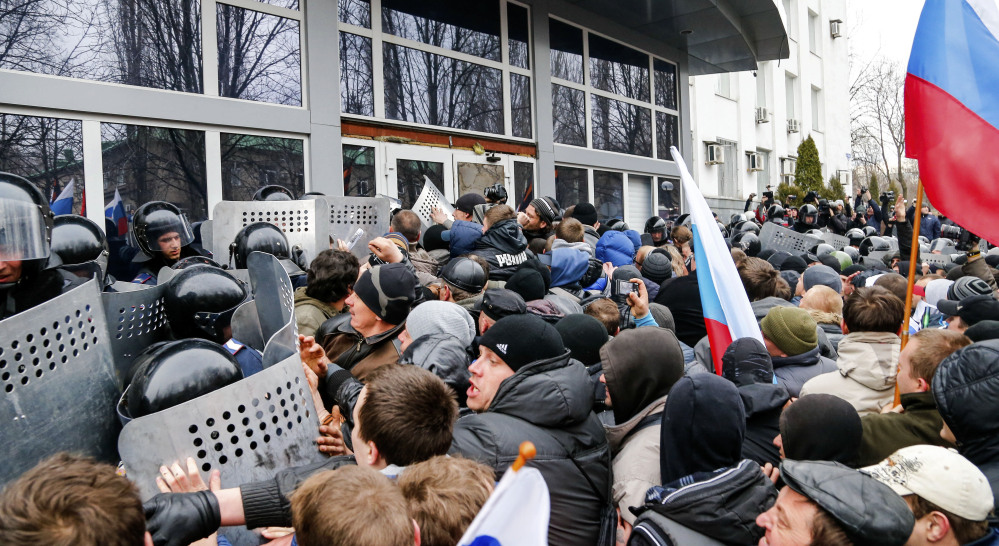 Pro-Russia demonstrators storm the Security Service building Sunday in Donetsk, a key city in eastern Ukraine. The demonstrators called for a secession referendum similar to the one in Crimea, which could lead to further divisions in the Ukrainian nation of 46 million.