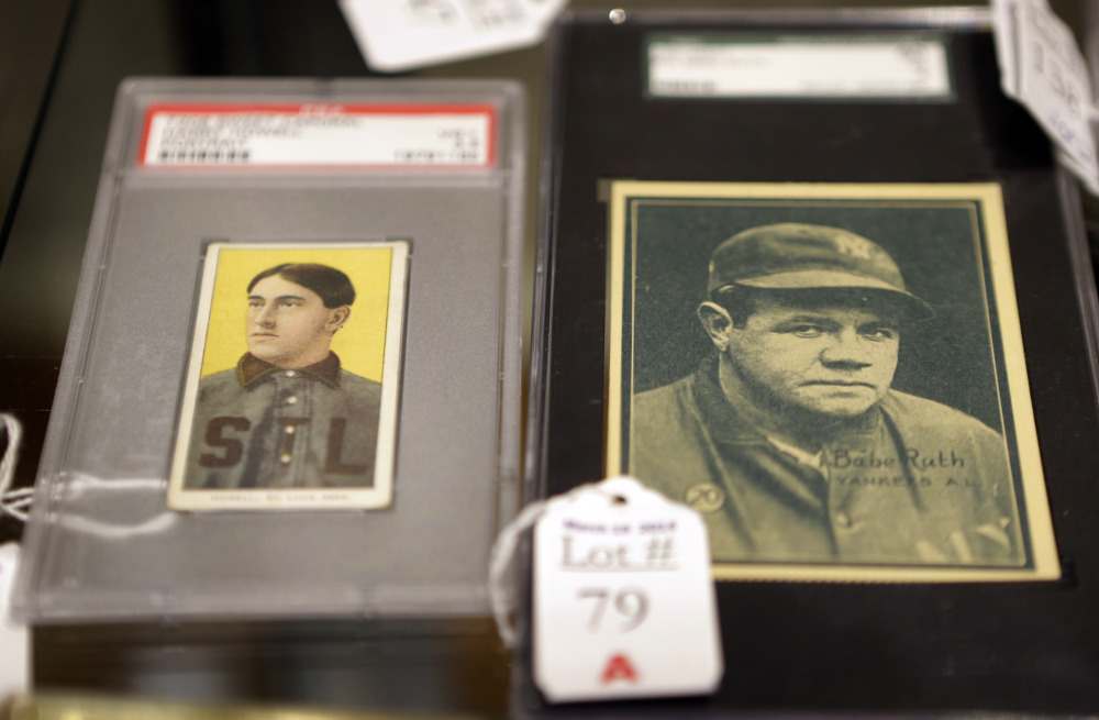 Baseball cards of major leaguers Harry Howell, left, and Babe Ruth displayed at the Saco River Auction House in Biddeford.