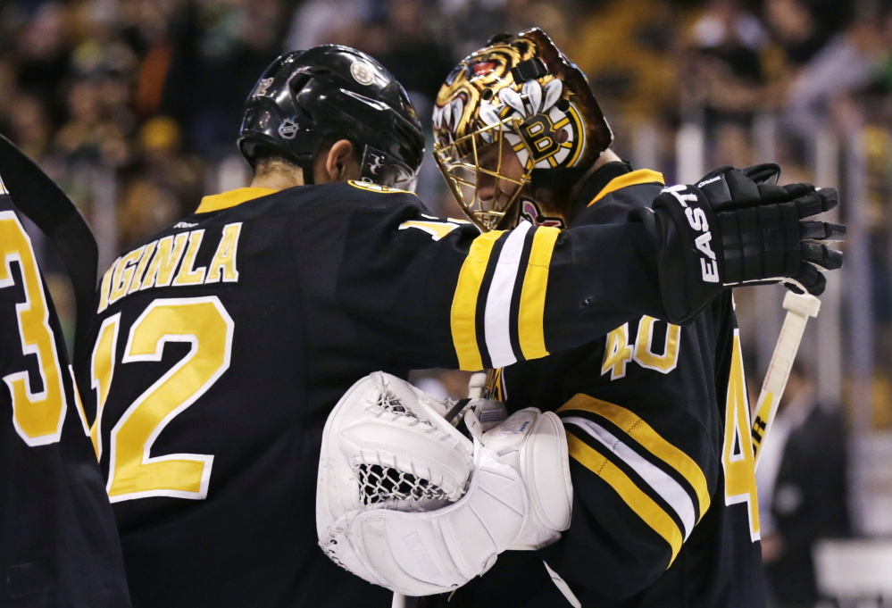 Boston Bruins goalie Tuukka Rask (40) is congratulated by Boston Bruins right wing Jarome Iginla after defeating the Minnesota Wild 4-1 in an NHL hockey game, Monday, March 17, 2014, in Boston. Iginla had two goals and Rask made 33 saves in the Bruins win. (AP Photo/Charles Krupa) Boston Bruins goalie Tuukka Rask (40) is congratulated by Boston Bruins right wing Jarome Iginla after defeating the Minnesota Wild 4-1 in an NHL hockey game, Monday, March 17, 2014, in Boston. Iginla had two goals and Rask made 33 saves in the Bruins win. (AP Photo/Charles Krupa)