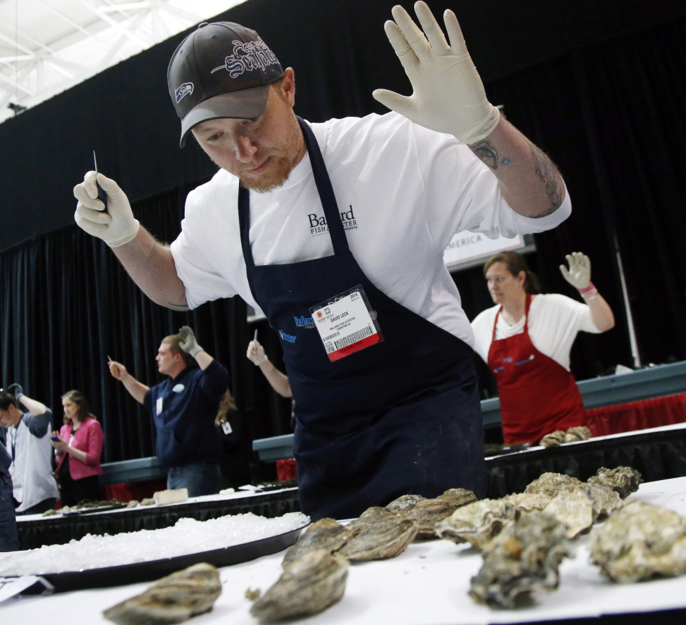 David Leck, of Ballard Fish & Oyster of Cheriton, Va., gets set for an oyster shucking competition at the 33rd Seafood Expo North America trade show in Boston on Monday.