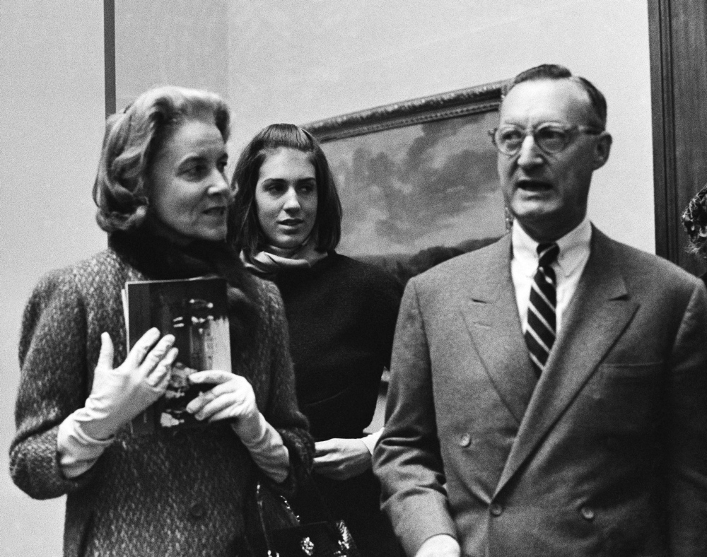 "Paul Mellon, his wife Rachel ""Bunny"" Mellon and stepdaughter Eliza Lloyd attend a preview of the Mellon collection of English Art at the Royal Academy in London on Dec. 11, 1964. The Mellons were avid art collectors."