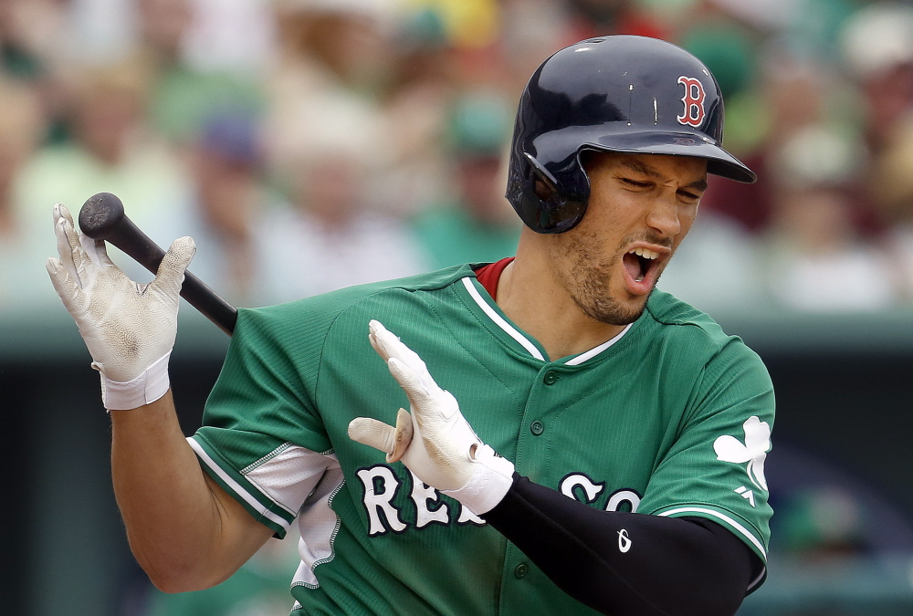 Grady Sizemore reacts after fouling a pitch off his leg during Monday's exhibition game, but at least he wasn't hurt. Sidelined by injuries for two seasons, he's having a torrid spring and that presents somewhat of a happy dilemma for the talent-rich Red Sox.