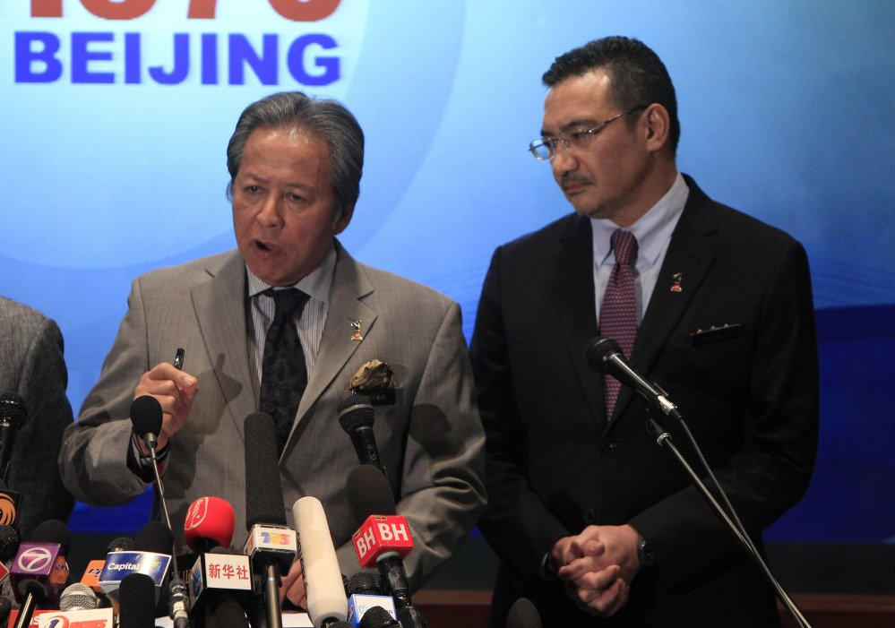 Malaysian Foreign Minister Anifah Aman, left, speaks as Malaysian acting Transport Minister Hishammuddin Hussein listens during a press conference at a hotel in Sepang, Malaysia Tuesday, March 18. Checks into the background of all the Chinese nationals on board the missing Malaysian jetliner have uncovered no links to terrorism, the Chinese ambassador in Kuala Lumpur said.