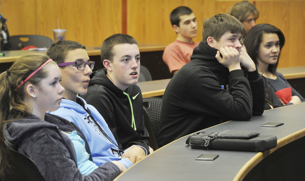 South Portland High School students listen to Gov. Paul LePage talk about some of his personal issues with abuse as a young man Tuesday. The governor was on hand to watch a video featuring students speaking out against bullying.