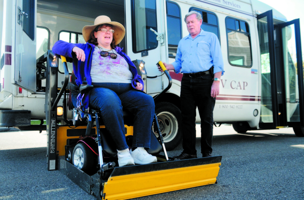 Cindy Dow is lifted into a Kennebec Explorer bus last fall for a ride from her Augusta home to an appointment. Rides arranged by Coordinated Transportation Solutions often fail to show up or are late, Dow and others have said. State officials haven't explained why CTS was paid an extra $1.2 million in February.