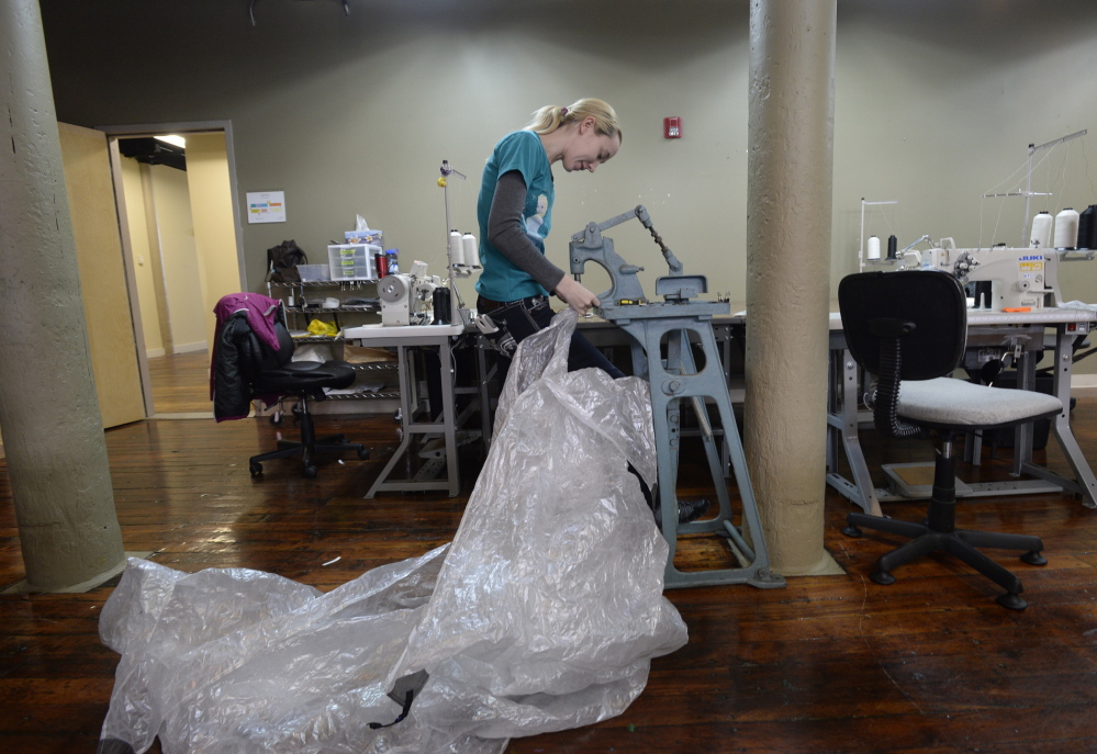 Kelly Fennell stitches a tent at Hyperlite Mountain Gear's production space in Biddeford.