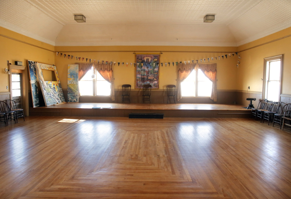 The Beehive Collective purchased the Machias Valley Grange Hall in 2001 and restored it with volunteers and using money raised through its art projects. It owns the building and pays the taxes on it but has turned it back over to the Grange and the community for public gatherings, including dances held on the second floor of the Grange, pictured here.