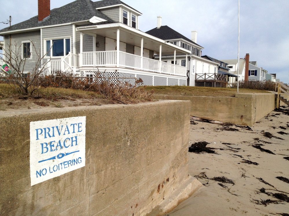 Property owners on Moody Beach in Wells, above, won a landmark 1989 case affirming private ownership of the shore straight to the low-water mark.