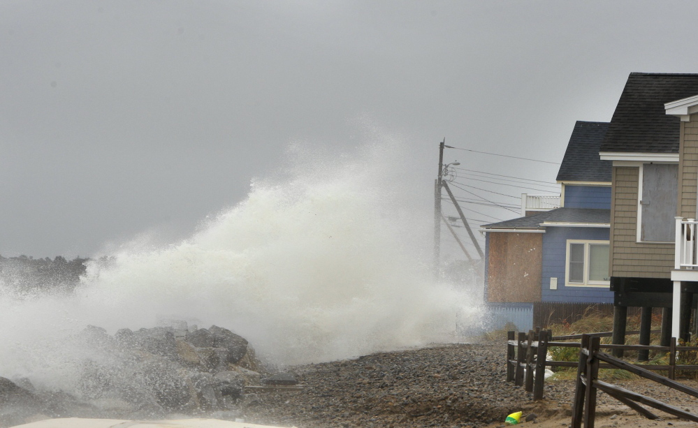 A wave comes over a sea wall in Saco  at high tide during Superstorm Sandy in October 2012.