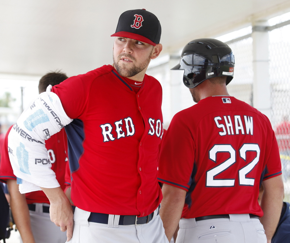 Pitcher Anthony Ranaudo, left, his arm iced, is thought to be catching up with his potential. While he'll probably start the season in Pawtucket, Boston might come calling.